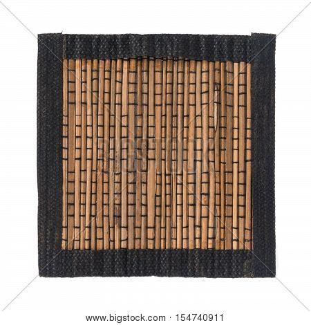 Brown bamboo straw mat with black fabric border for background and texture isolated on white background