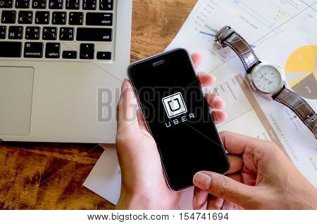 CHIANG MAITHAILAND - AUG 22016 : A woman hand holding Uber app showing on Samsung note 3Uber is smartphone app-based transportation network.