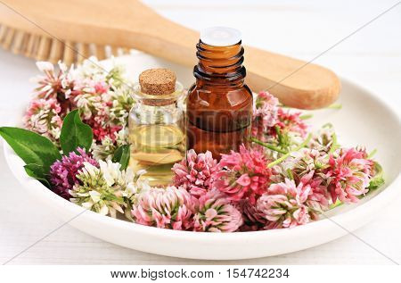 Red clover extract and aroma essenial oil for natural cosmetic haircare treatment.
