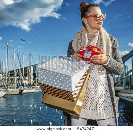Fashion-monger With Christmas Present Box Looking Into The Distance