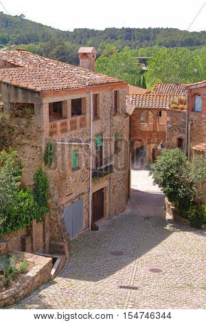The picture was taken in Spain in the province of Girona. The picture shows one of the many picturesque villages of the province.