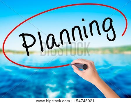 Woman Hand Writing Planning With A Marker Over Transparent Board