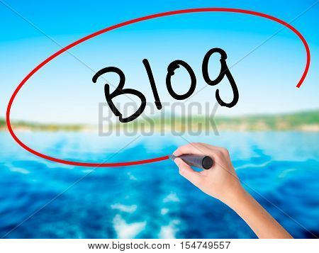 Woman Hand Writing Blog With Marker On Transparent Wipe Board