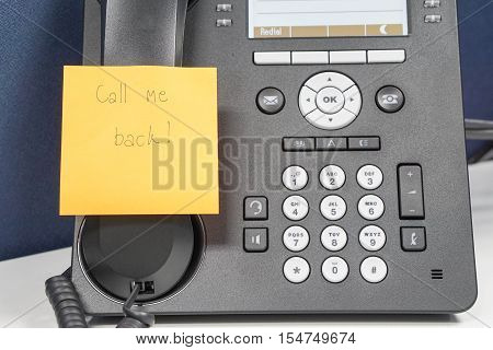close up message on sticky note of calling back attach on IP phone