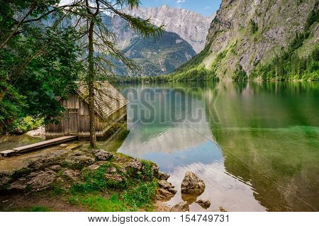 Small wooden boathouse or cabin at Obersee lake Berchtesgaden Germany