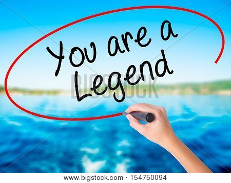 Woman Hand Writing You Are A Legend   With A Marker Over Transparent Board