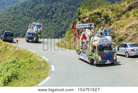 Col D'AspinFrance- July 15 2015: Carrefour Caravan during the passing of the Publicity Caravan on the Col d'Aspin in Pyerenees Mountains in the stage 11 of Le Tour de France 2015.