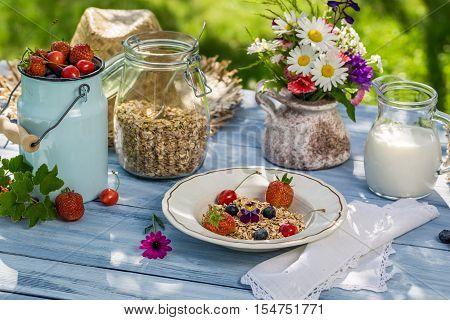 Summer breakfast in the garden on old table