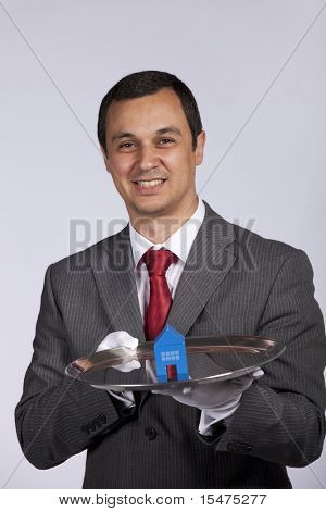 happy businessman showing you house services solutions