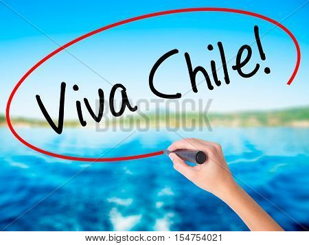 Woman Hand Writing Viva Chile! With A Marker Over Transparent Board