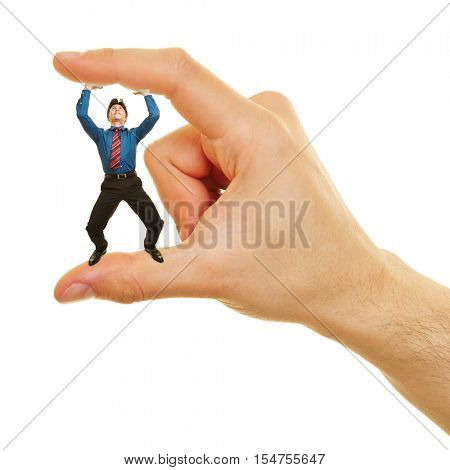 Small business man standing between two fingers