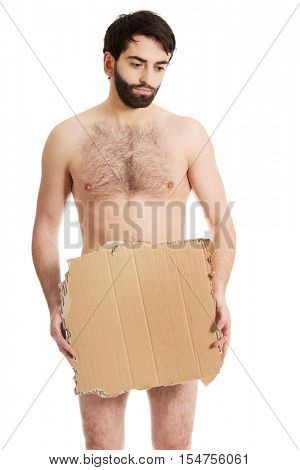 Hopeless undressed man with a piece of cardboard.