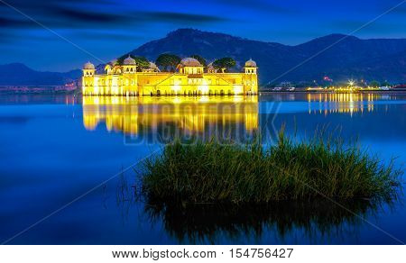 Palace Jal Mahal at sunset. Jal Mahal (Water Palace) was built during the 18th century in the middle of Man Sager Lake. Jaipur Rajasthan India Asia