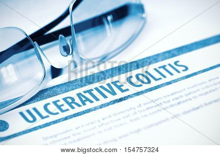 Diagnosis - Ulcerative Colitis. Medicine Concept on Blue Background with Blurred Text and Eyeglasses. Selective Focus. 3D Rendering.