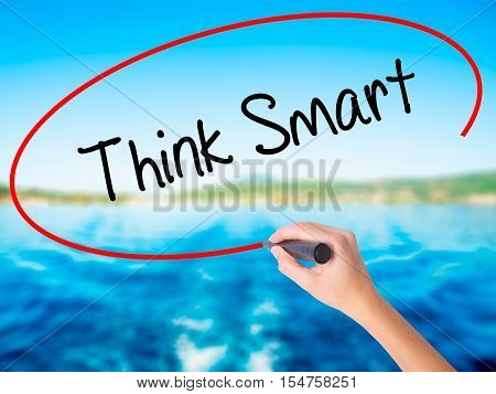 Woman Hand Writing Think Smart  With A Marker Over Transparent Board