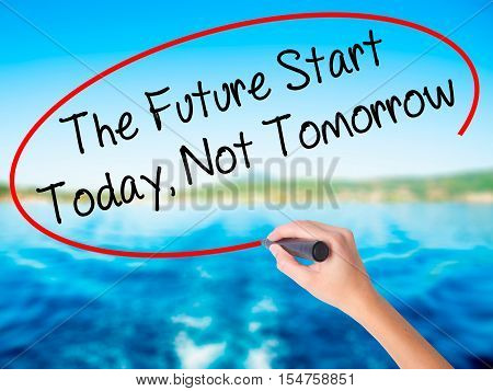 Woman Hand Writing The Future Start Today, Not Tomorrow With A Marker Over Transparent Board.
