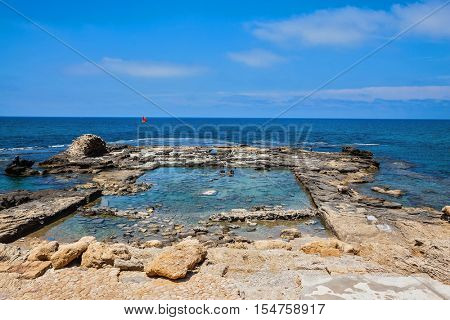 The remains of the ruined castle walls in the Mediterranean. National Park Caesarea, Israel