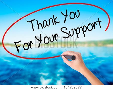 Woman Hand Writing Thank You For Your Support  With A Marker Over Transparent Board