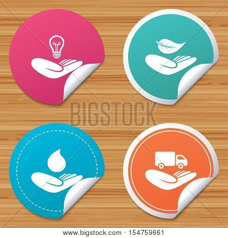 Round stickers or website banners. Helping hands icons. Intellectual property insurance symbol. Delivery truck sign. Save nature leaf and water drop. Circle badges with bended corner. Vector