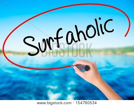 Woman Hand Writing Surfaholic  With A Marker Over Transparent Board