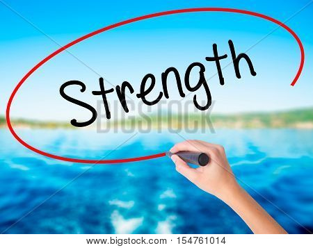 Woman Hand Writing Strength With A Marker Over Transparent Board