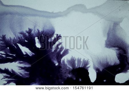 Splashes chaotic ink spots on a white background. Ink blue drops and splatters on white background
