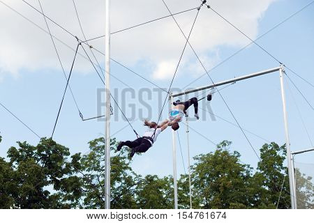 MOSCOW - MAY 26, 2016: Acrobats show. In Moscow, opened first in Russia trapeze for Air flight school and aerial gymnastics Trapeze Yota - school and show