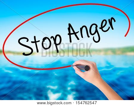 Woman Hand Writing Stop Anger With A Marker Over Transparent Board
