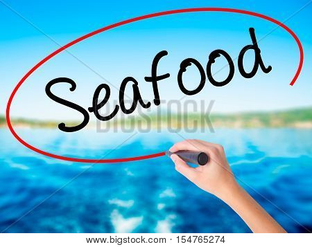 Woman Hand Writing Seafood With A Marker Over Transparent Board