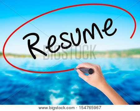Woman Hand Writing Resume With A Marker Over Transparent Board