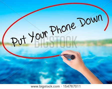 Woman Hand Writing Put Your Phone Down With A Marker Over Transparent Board