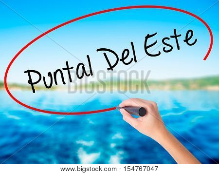 Woman Hand Writing Puntal Del Este With A Marker Over Transparent Board