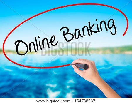 Woman Hand Writing Online Banking With A Marker Over Transparent Board