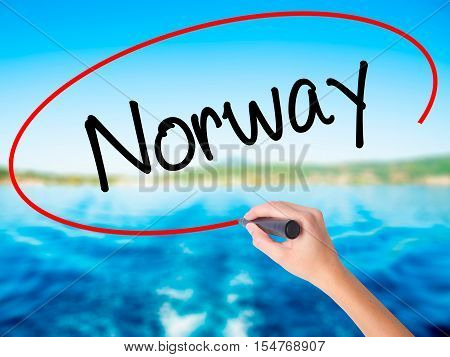 Woman Hand Writing Norway  With A Marker Over Transparent Board
