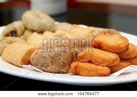 Deep Fried Fish Bean Cake, Deep Fried Mash Taro, Deep Fried Spring Roll, Deep Fried Chinese Chives in a white dish ,Dim Sum, Chinese cuisine, Food.