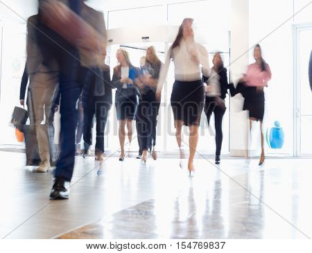 Blurred motion of business people walking in convention center