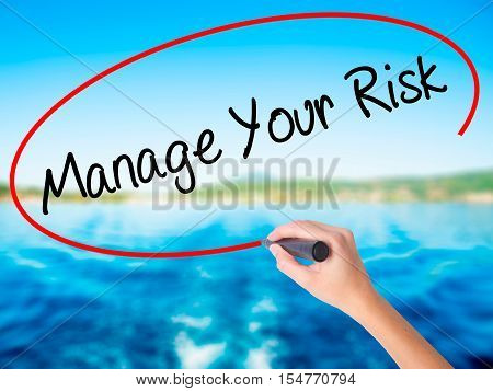 Woman Hand Writing Manage Your Risk With A Marker Over Transparent Board