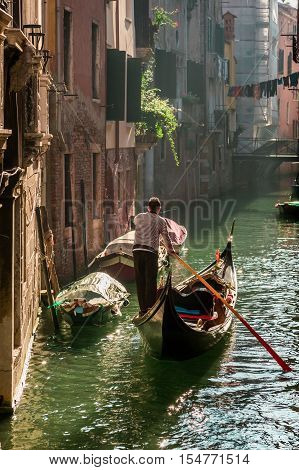 Lone gondolier in Venice Floating in summer