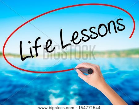 Woman Hand Writing Life Lessons With A Marker Over Transparent Board