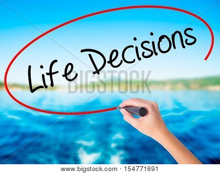 Woman Hand Writing Life Decisions With A Marker Over Transparent Board.
