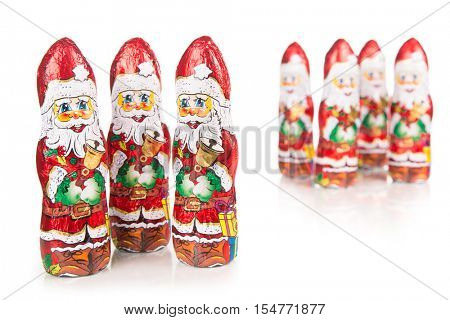 Closeup of Santa Claus chocolate figurine .Isolated on a white background