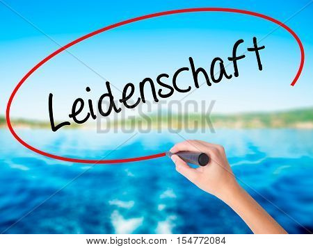 Woman Hand Writing Leidenschaft (passion In German)  With A Marker Over Transparent Board