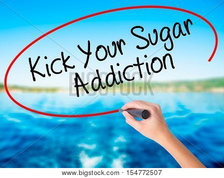 Woman Hand Writing Kick Your Sugar Addiction With A Marker Over Transparent Board