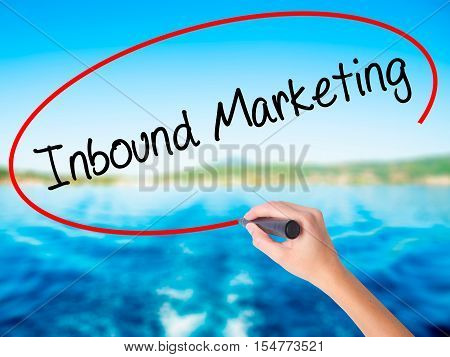Woman Hand Writing Inbound Marketing  With A Marker Over Transparent Board