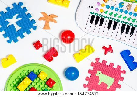 Educational toys for babies colorful balls, mats, building blocks, mini piano collection on white background