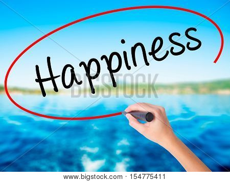 Woman Hand Writing Happiness With A Marker Over Transparent Board