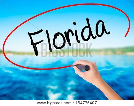 Woman Hand Writing Florida  With A Marker Over Transparent Board