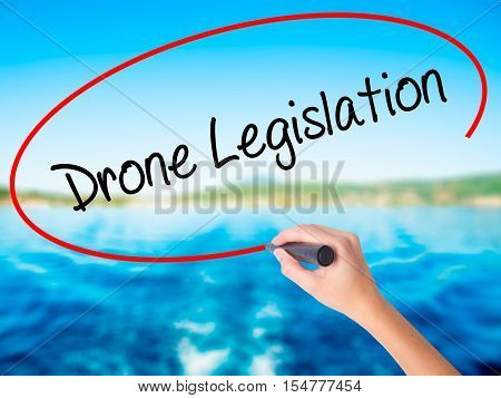 Woman Hand Writing Drone Legislation With A Marker Over Transparent Board