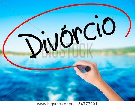 Woman Hand Writing Divorcio (divorce In Portuguese) With A Marker Over Transparent Board.