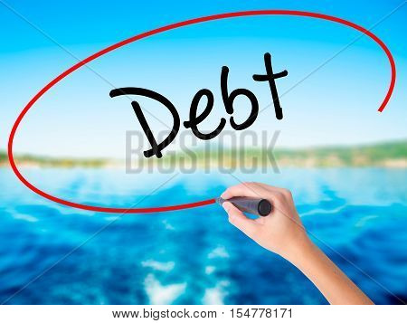 Woman Hand Writing Debt With A Marker Over Transparent Board